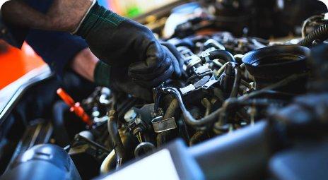 mechanic hand fixing car