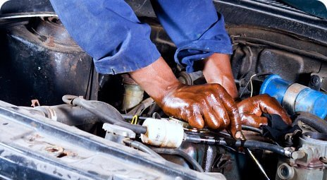 hand of a mechanic fixing