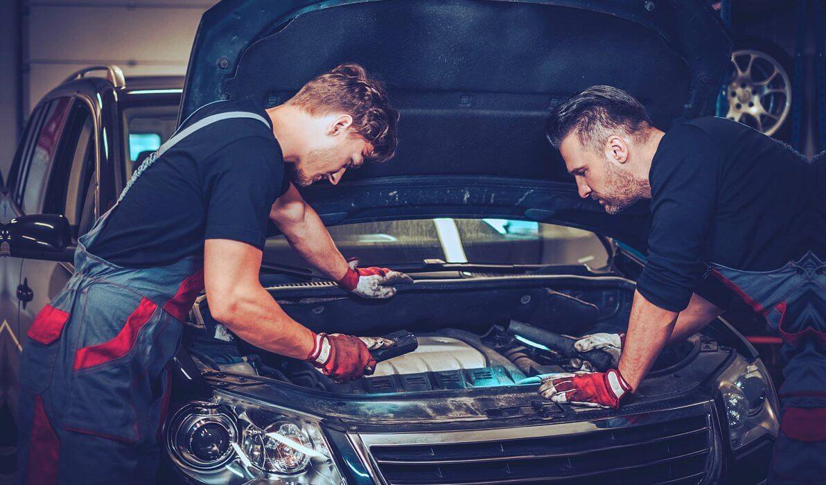 car mechanics working together