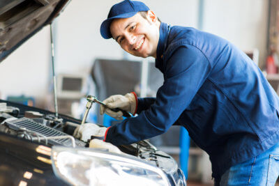 car mechanic smiling facing at the camera